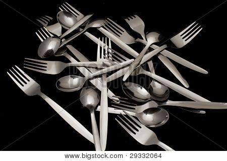Forks And Spoons On A Black Background