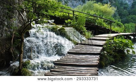Beautiful Cascade Waterfalls And Wooden Pathway Over The Water, Plitvice Lakes In Croatia, National