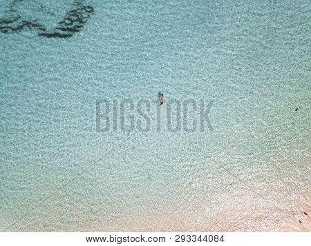 Female Snorkeler In Turquoise Waters. Exuma Bahamas