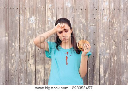 Clumsy Woman Staining Her Shirt With Ketchup Sauce