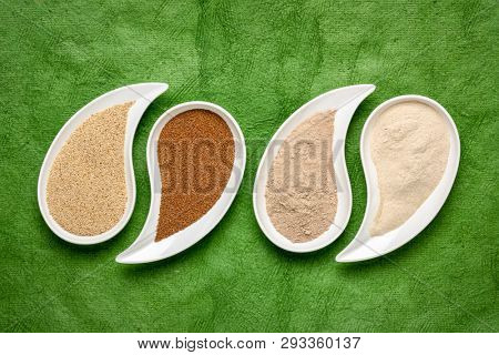 gluten free brown and ivory teff grain and flour on teardrop shaped bowls against green textured paper - important food grain in Ethiopia and Eritrea