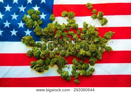 Marijuana. Cannabis. American Flag. Marijuana buds on an American Flag. Isolated on white. Room for text. Legal Cannabis. Legal Pot. USA. Grown in the USA. American Made. Medical Cannabis. Recreation