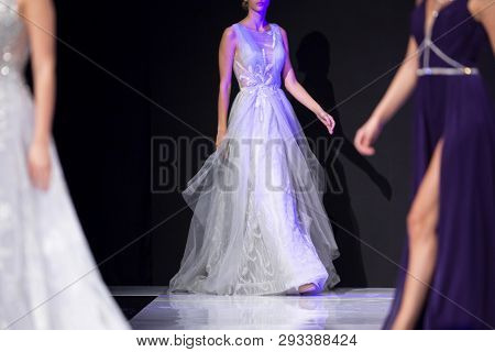 Sofia, Bulgaria - 19 September, 2018: Female Models Walk The Runway In White And Purple Dresses Duri