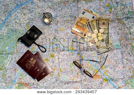 Glasses, A Glass Globe, Passports,  Camera And Money On A Tourist Map Background. Tourism Concept.
