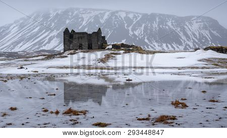 Old Farmhouse In Front Of A Mountain, Andscape Along The Southern Coast Of Iceland At Wintertime