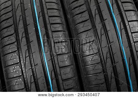 Studio Shot Of A Set Of Summer Car Tires On Black Background. Tire Stack Background. Selective Focus