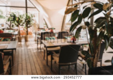 Abstract Blur Resort Coffee Shop Cafe Interior For Background. Wooden Floor, Cozy Atmosphere, Sunny