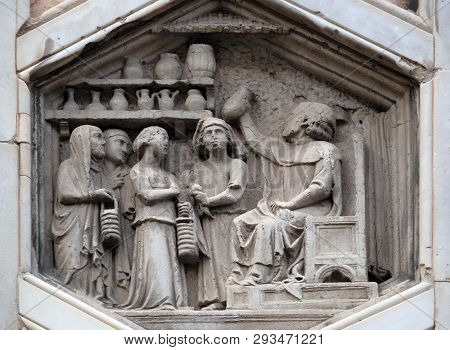 FLORENCE, ITALY - JANUARY 09, 2019: Allegory of medicine from the workshop of Andrea Pisano, Relief on Giotto Campanile of Cattedrale di Santa Maria del Fiore, Florence, Italy