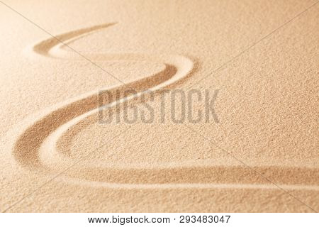 Sand texture background with line pattern. Minimal zen meditation garden. Concept for yoga, spa wellness or buddhism and mindfulness.  With copy space.