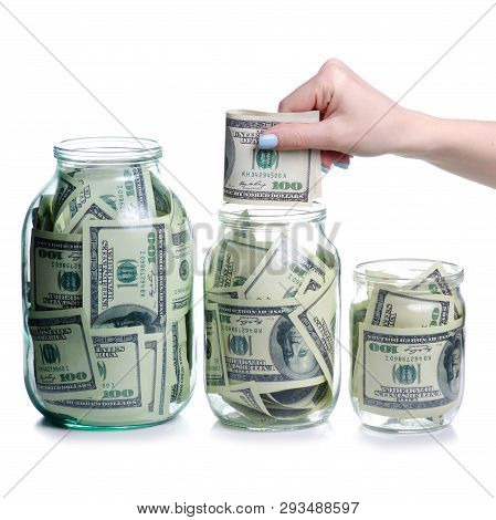 Money Dollars Bank Notes In Glass Jar, Hand Put Money Isolated On White Background, Concept Save Mon