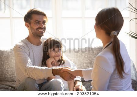 Daughter With Father Having Visit Paediatrics Handshaking With Paediatrician