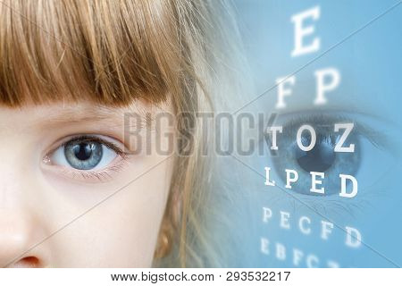 A Closeup Of A Small Child Face Part With Eye Is Sideways Of Checking Table With Letters And Digital