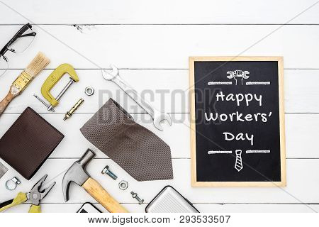 Happy Workers' Day Background Concept. Flat Lay Of Construction Blue Collar Handy Tools And White Co