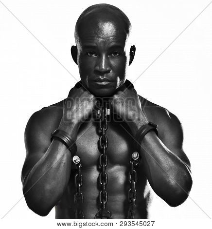 Strong Black Man In Chains Reminiscent Of A Slave