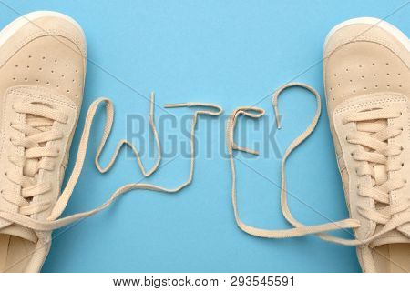 Women Sneakers With Laces In Wtf Text.