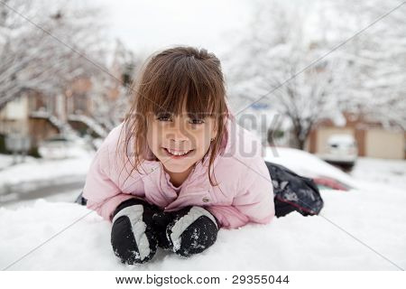Winter Portrait Of A Happy Little Girl