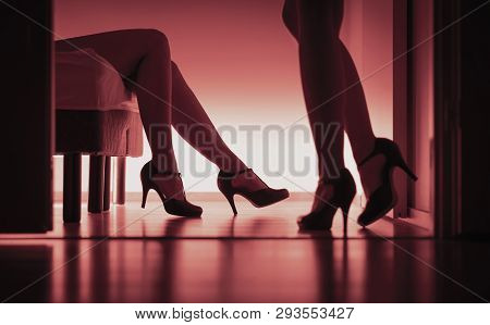 Two Sexy Ladies In High Heels. Women Having Sex. Lesbians, Prostitutes Or Escorts. Long Legs Silhoue
