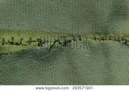 Green Cloth Texture With Black Stitching On The Fabric