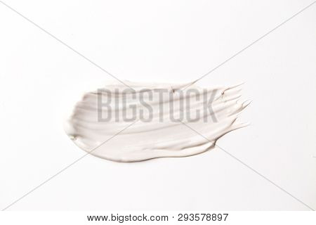 Closeup Of Cosmetic Face Cream, Mask Or Skin Care Lotion Sample Isolated On White Background. Smear