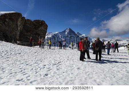 Traveler Taking Photao And Relaxing At First Peak Jungfau , Grindelwald Switzerland