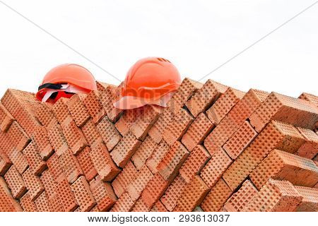 Construction Helmets Close-up On A Construction Site. Construction Helmets As Protection While Worki