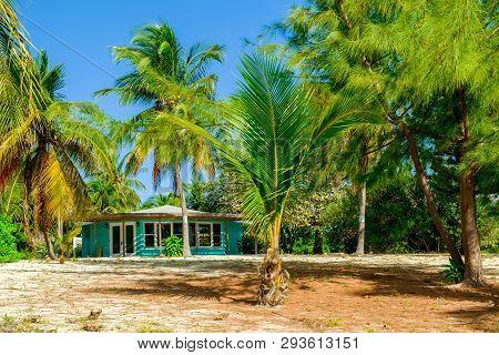 Little Cayman, Cayman Islands, Nov 2018, Turquoise Caribbean-style House On South Hole Sound