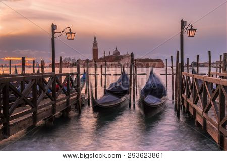 Gondolas At Rest Before Their Hectic Day Begins.  Taken In Venice, Italy