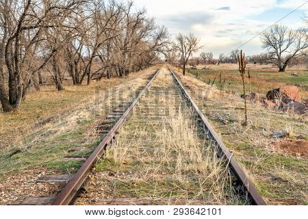abandoned  railroad tracks in a prairie of eastern Colorado