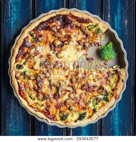 Broccoli Quiche Made In The Oven And Presented On A Blue Wooden Board