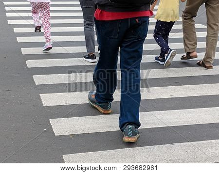 Jakarta, Indonesia - February 16, 2019: Some People Walking On The Pelican Crossing On Jalan Thamrin