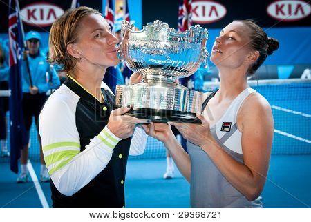 MELBOURNE - JANUARY 27: Svetlana Kuznetsova and Vera Zvonareva of Russia winning the doubles championship at the 2012 Australian Open on January 27, 2012 in Melbourne, Australia.