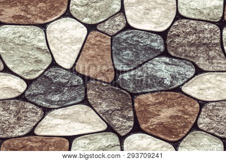 Wall Round Stone Rock Texture And Seamless Background. Pale Color Of The Stones. Marble Texture.