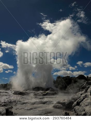 Te Whakarewarewa Geothermal Valley, Te Puia/new Zealand-march 6, 2014: Water And Steam Thrown By The