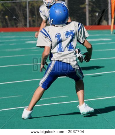 Youth Teen Running Ready To Catch Ball