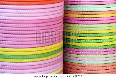 Plates Of Various Colors Piled On Each Other
