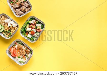 Healthy Food Delivery. Take Away Of Organic Daily Meal On Yellow, Copy Space. Clean Eating Concept,