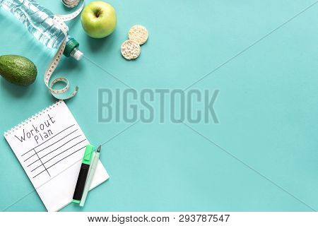Workout Plan Mockup With Water, Fruits And Measuring Tape. Fitness, Diet  And Healthy Lifestyle Conc