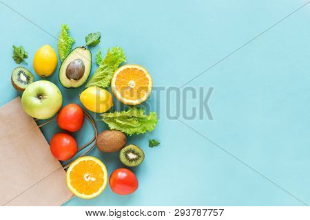 Healthy Food Background. Healthy Food In Paper Bag Vegetables And Fruits On Blue, Copy Space. Shoppi