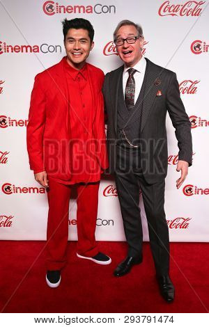 LAS VEGAS-APR 4: Henry Golding (L) and director Paul Feig at The CinemaCon Big Screen Achievement Awards at OMNIA Nightclub at Caesars Palace at CinemaCon 2019 on April 4, 2019 in Las Vegas, Nevada.
