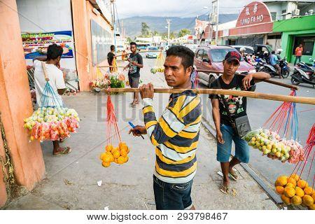 Dili, Timor-leste - Aug 10, 2015: Local Native Timorese Men, Street Vending Fruits And Vegetables Ha