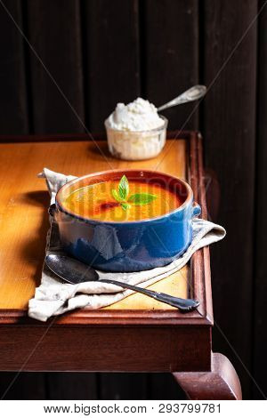 Grilled Pepper And Mascarpone Soup On A Wooden Table