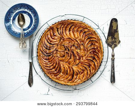 Baked Apple Tart On A Rack To Cool Before Being Sliced