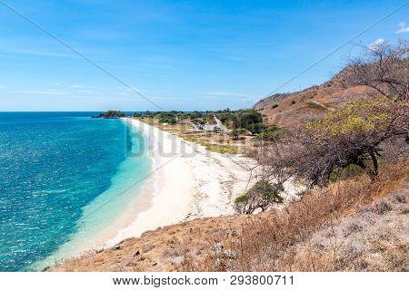 One Dollar Beach. Idillic Yellow Sandy Beach Of East Timor, Timor-leste. Coastline With Hills, Mount