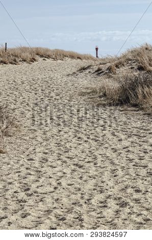 Sandy Path Climbing Over Sand Dunes Near Cape Cod Canal With Navigation Aid Peeking Over Dune
