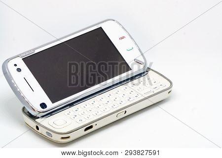 3 April 2019, Eskisehir, Turkey. Nokia Ngage And N97 Vintage Smartphones On White Isolated Backgroun