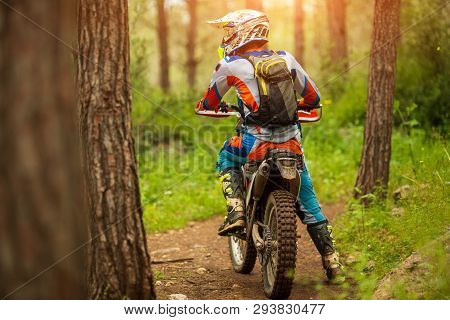 Motocross Racer Racing On The Off-road Circuit Mud Flying