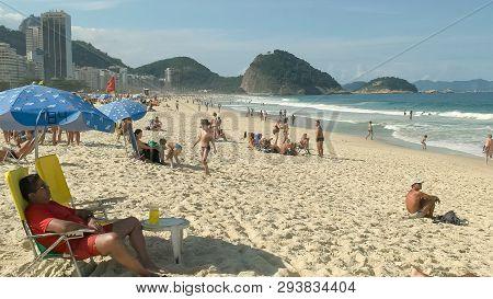 Rio De Janeiro, Brazil- 25, May, 2016: Beachgoers On Copacabana Beach In Rio