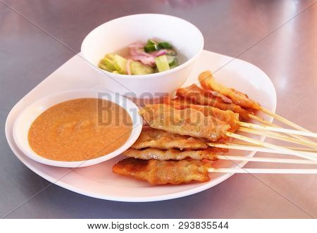 Food And Cuisine, A Plate Of Grilled Pork Satay On Bamboo Skewer Served With Sweet Soy Sauce And Cuc