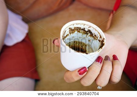 Turkish Coffee And Traditional Fortunetelling In Woman Hand