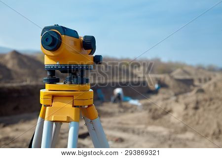 Special Device (level) For Surveyor Builders, Geodesy Equipment Close Up In Front Of A Ground Work W